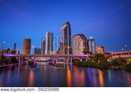 The Skyline Of Downtown Tampa After Sunset With Hillsborough River In The Foreground. Long Exposure.