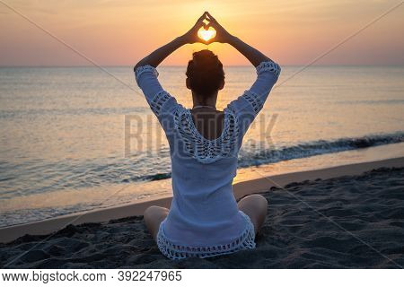 Woman Doing Yoga In Nature. Yoga In Nature. Yoga Lifestyle. Healthy Lifestyle. Woman Doing Yoga On B