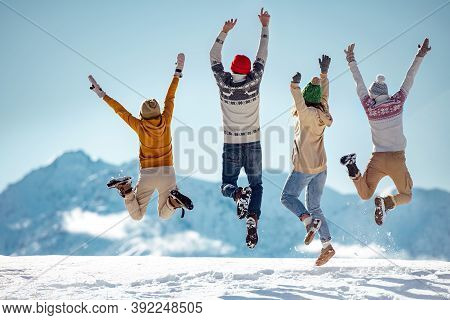 Friends Celebrates Beginning Of Winter In Mountains, Jumps And Having Fun