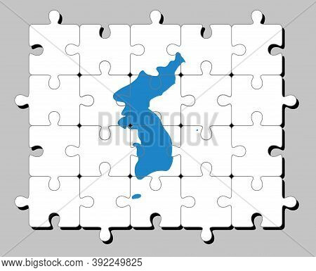 Jigsaw Puzzle Of Unification Korea Flag, Korean Peninsula In Blue On White.concept Of Fulfillment Or