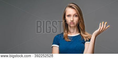 What The Hell Are You Talking About, Nonsense. Studio Shot Of Frustrated Female With Blonde Straight