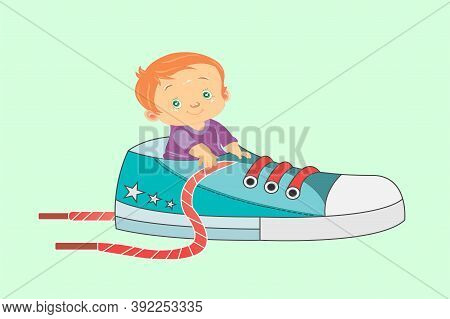 Little Boy With Red Hair Green Eyes Dressed In A Purple T-shirt Sits In A Sneaker With Red Shoelaces