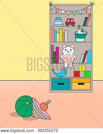A Cupboard With Toys And Books Is Standing Near The Wall, On The Floor On The Carpet Are A Ball And