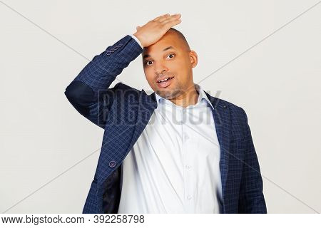 Portrait Of Surprised Young African American Businessman Guy, Resting Hand On Head For Mistake, Reme