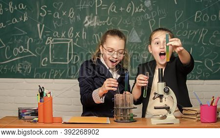 It Is Unbelievable. Science Experiments. Little Girls Scientist Work With Microscope. Biology Scienc