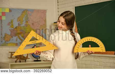 School Lesson Items. High School Student Learning Geometry In Class. Measure Angles In Degrees. Smal