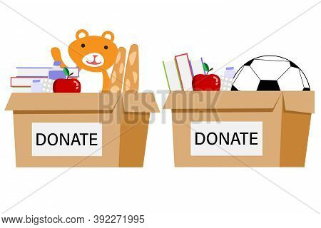 Cardboard Box For Donations. Box Full Of Things For Donation From Food, Medicine, Books, Ball, Bear.