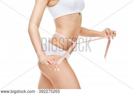 Slim Tanned Womans Body Isolated On White Background - Waist Measurement