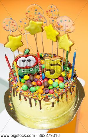 Delicious Yellow Cake For The Birthday Of A 5-year-old Child, Yellow Stars And Transparent Candles O