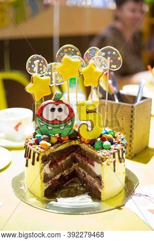Yellow Chocolate Cake Cut Into Pieces On The Birthday Of A 5-year-old Child, Yellow Stars And Transp