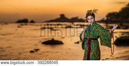 Fine art portrait of european woman in Japanese Geisha style wearing kimono