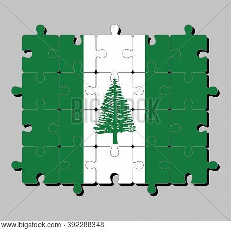 Jigsaw Puzzle Of Norfolk Island Flag In Norfolk Island Pine In A Central White Stripe Between Two Gr