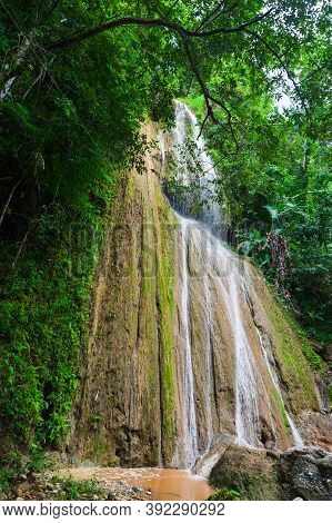 Vertical Landscape Photo With Waterfall In Tropical Forest. Samana, Dominican Republic
