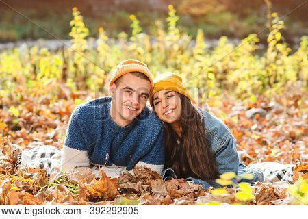 Couple In Love Enjoying Autumn. Fashionable Couple On A Walk In Nature. Love, Relashionship And Life