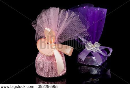 Two chocolate candies isolated on black background, gift