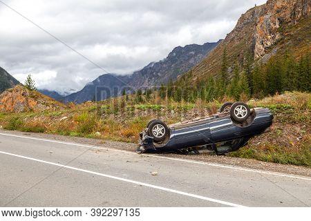 Overturned Car Lies On The Roof, Broken Bumper
