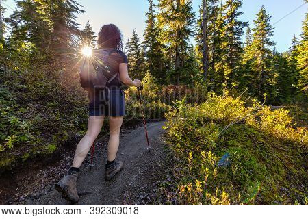 Girl Hiking Along Scenic Trail On A Fall Evening In Canadian Nature. Taken In Whistler, North Of Van