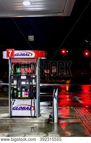 NORWALK, CT, USA-OCTOBER 30, 2020: Global gas station with traffic lights  in rainy October morning on Connecticut Avenue