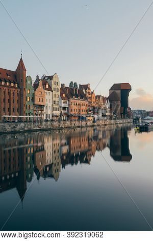 Cityscape of Gdansk old town on the river Motlawa. Old Town of Gdansk at dawn, Poland.