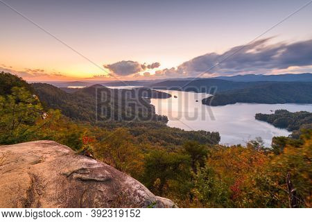 Lake Jocassee, South Carolina, USA in early autumn at sunset.