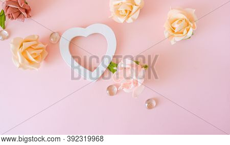 Roses Background With White Heart Flame. Various Pink Roses Flowers Buds And Petals Scattered On Pas