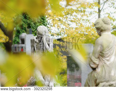 Granite Male And Female Statues Secure Tombstones.  24th Of October 2020. Hronov, Czechia.  Statue D