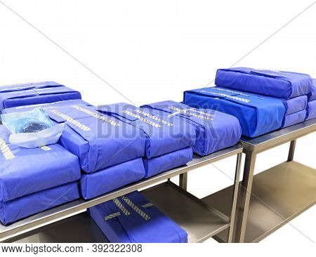 Wrapped Sterile Surgical Instruments Sets In Table