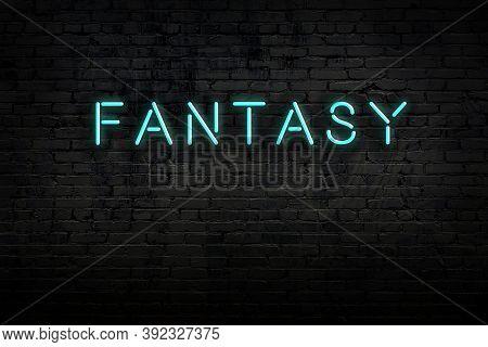Neon Sign On Brick Wall At Night. Inscription Fantasy