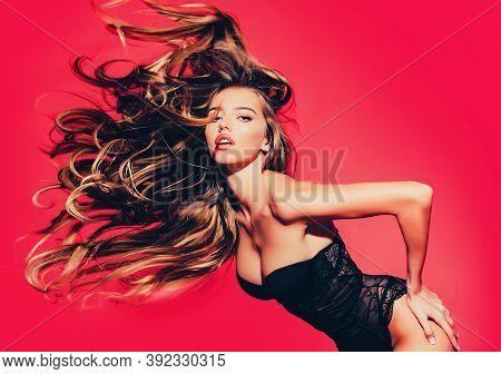 Fashion Shot Of A Female Model In Studio. Studio Fashion Shot. High Fashion Model Woman With Colorfu