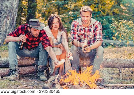 Happy Young Friends Having Picnic. Group Of Friends Enjoying Picnic In The Forest. Happy Friends On