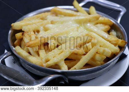 Cheesy French Fries With Melted Cheese In A Bowl