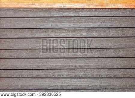 Vinyl Brown Siding, Texture And Horizontal Plastic Background.