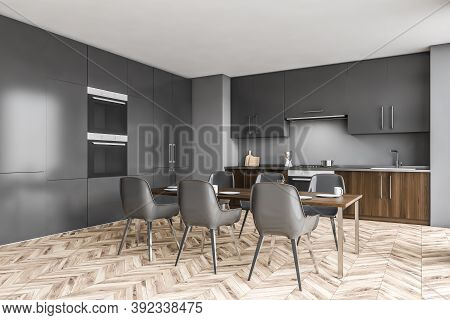 Corner Of Minimalist Kitchen With Gray Walls, Wooden Floor And Grey Cupboards With Built In Sink And