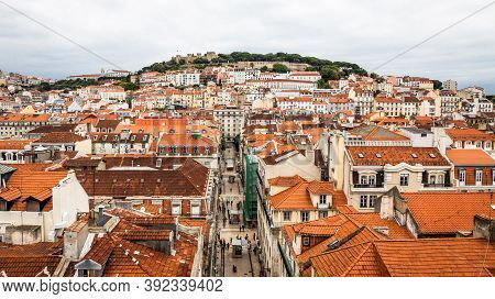Skyline Aerial View Of Lisbon Old City, Portugal. View To Rua De Santa Justa Street And Castle Of Sa