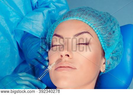 Hyaluronic Acid Injection For Facial Rejuvenation Procedure In Nasolabial Fold Wrinkle. Patient Rece