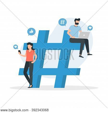 Social Media Users With Laptops And Smartphones Are Sitting On And Around Hashtag Sign. Social Media