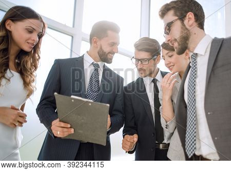 close up.business colleagues discussing business document