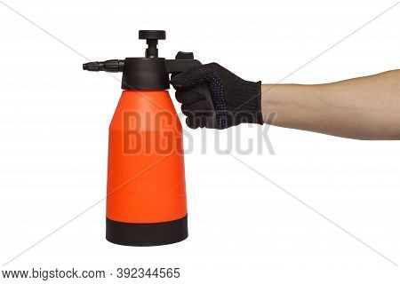 A Man's Hand Holds Hand-pumped Sprayer Isolated On White Background. Garden Pressure Sprayer For Dis