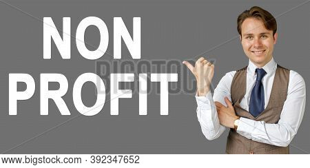 Emotional Portrait Of Businessman Showing Right Hand Gesture On Text - Non Profit. Gray Background.