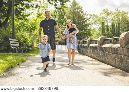 Happy Family Having Fun Resting In Park