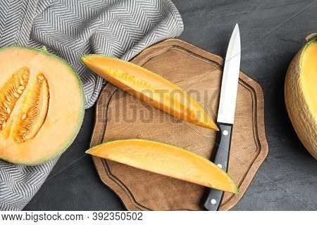 Tasty Fresh Melons On Black Table, Flat Lay