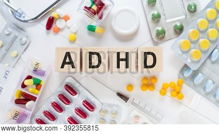Abbreviation On Adhd Attention Deficit Hyperactivity Disorder Cubes On Wooden Blocks On The Table. M