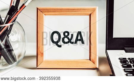Office Table And Wooden Frame With Q And A Word. Questions And Answer Concept