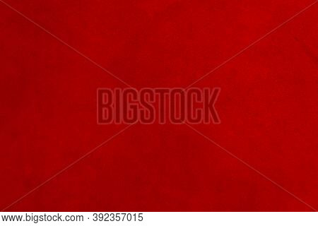 Red Matte Background Of Suede Fabric, Closeup. Velvet Texture Of Seamless Leather. Felt Material Mac