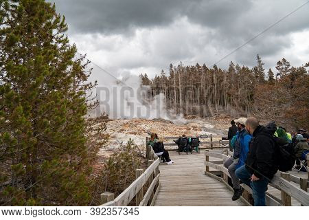 Yellowstone National Park - June 28, 2020: Tourists Gather, Waiting For The Steamboat Geyser To Erup