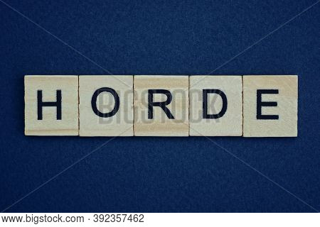 Gray Word Horde From Small Wooden Letters On A Black Table
