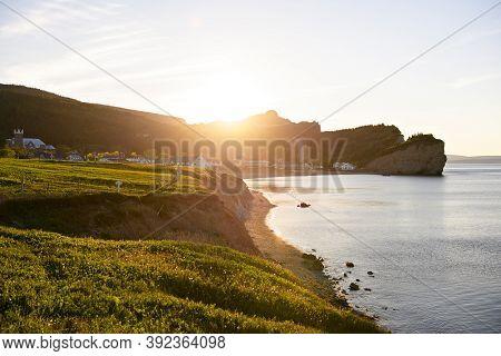A Bonaventure Island And Fisherman Houses And Perce Rock In Gaspesie