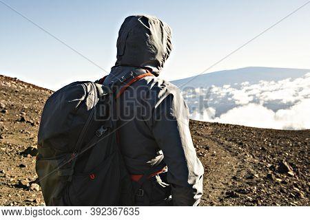 A Hiking Tourist Admiring Breathtaking View Of Mauna Kea Volcano On The Big Island Of Hawaii.