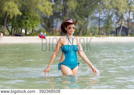 Woman In Blue Swimsuit Relax In Sea Water At Beach Koh Chang Thailand. Koh Chang Is Located In The E