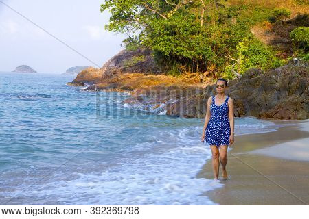Woman Walk With Sunshine Morning On Lonely Beach At Beach Koh Chang Thailand. Koh Chang Is Located I